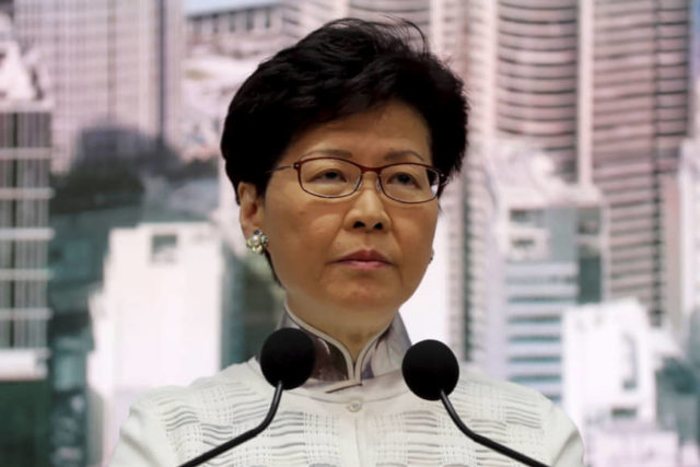 Hong Kong leader urges calm as protest tensions rise; airport reopens